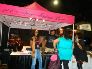 """Maya"" Magenta tent with black text. T-shirts on display at Bronner Bros Bonner Brothers Hair Show, Atlanta"