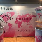 """Evolution"" Hair Trade Show Booth - back drop, product display shelf and podiums."