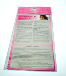 Plastic bag for human hair lace wigs. This picture of the back depicts the sealed header at top, The back of the card insert has hair care instructions and contact information